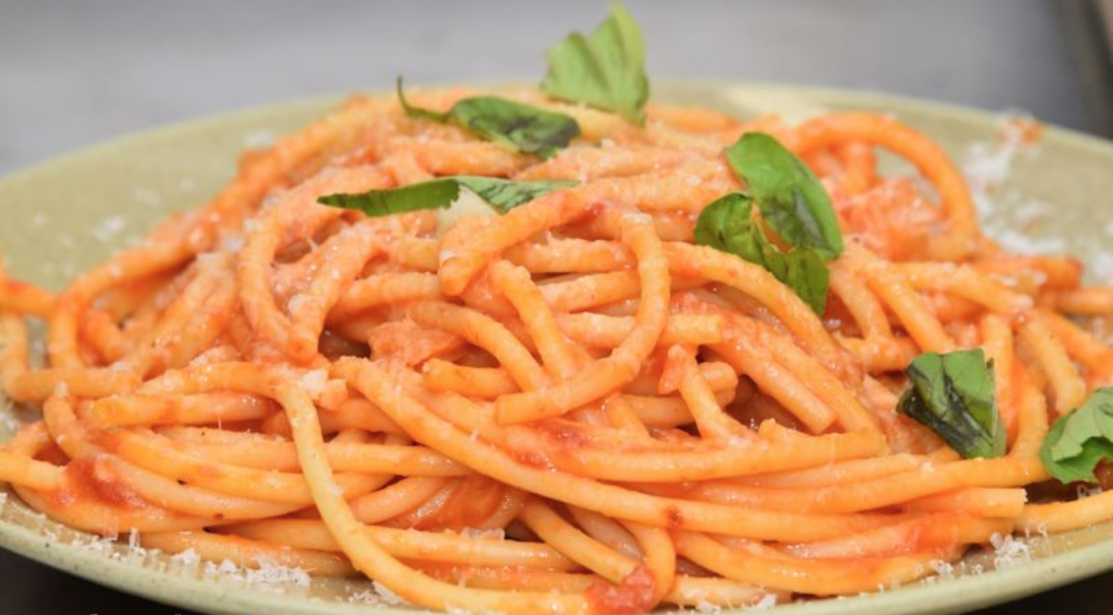 Bucatini pasta seasoned with flavorful sauce from organic tomatoes picked by CultureHorde members.