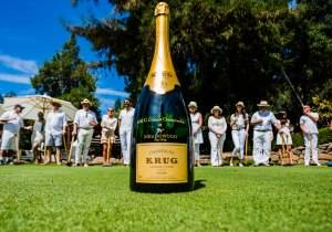 The empty magnum of Krug that serves as the tournament's cup.