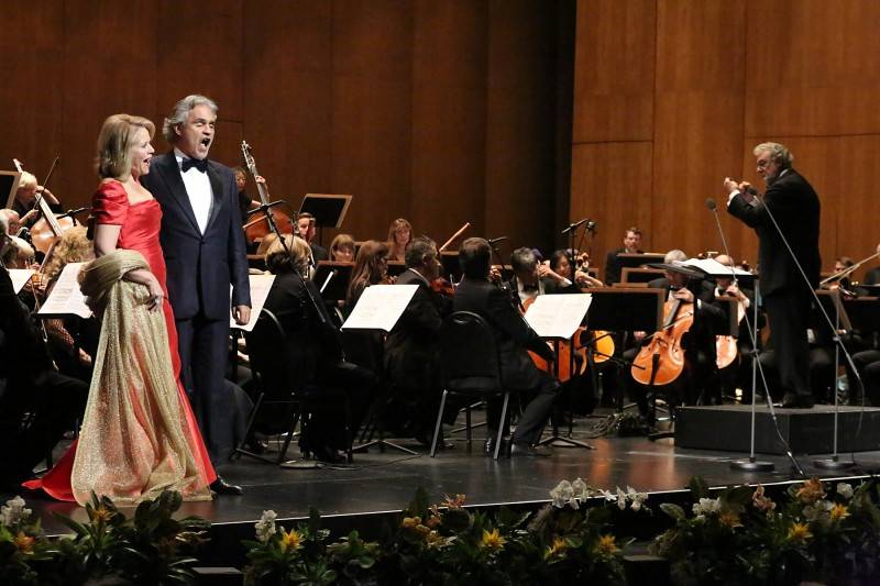 Renee Fleming and Andrea Bocelli and Placido Domingo onstage