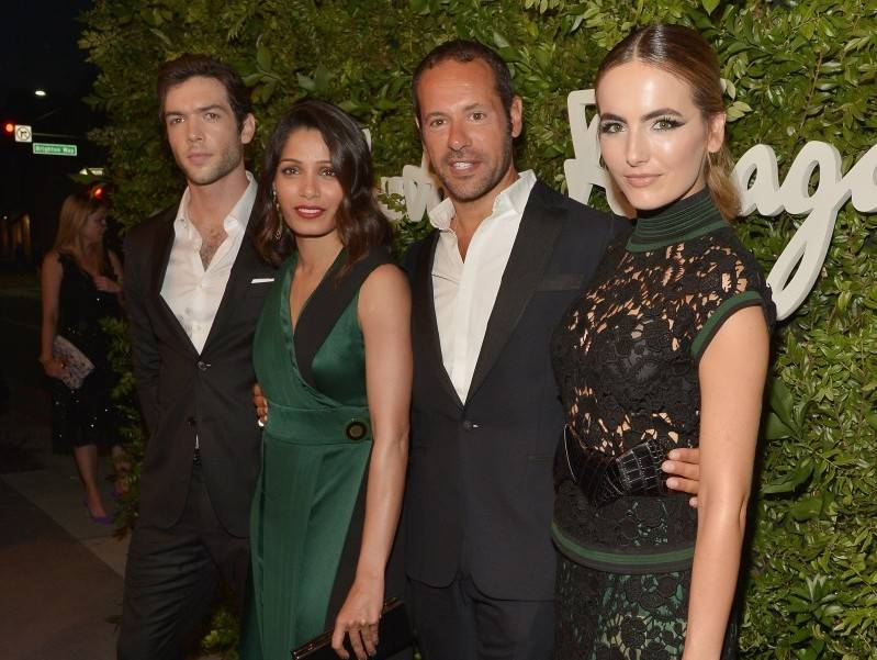 Actors Ethan Peck and Freida Pinto, creative director for Salvatore Ferragamo Massimiliano Giornetti and actress Camilla Belle attend as Ferragamo Celebrates 100 Years in Hollywood at the newly unveiled Ferragamo boutique on September 9, 2015 in Beverly Hills, California