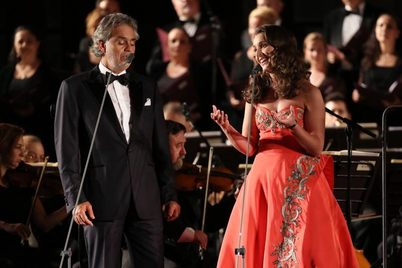 Singers Andrea Bocelli and Carly Paoli perform at the Celebrity Fight Night gala at Palazzo Vecchio