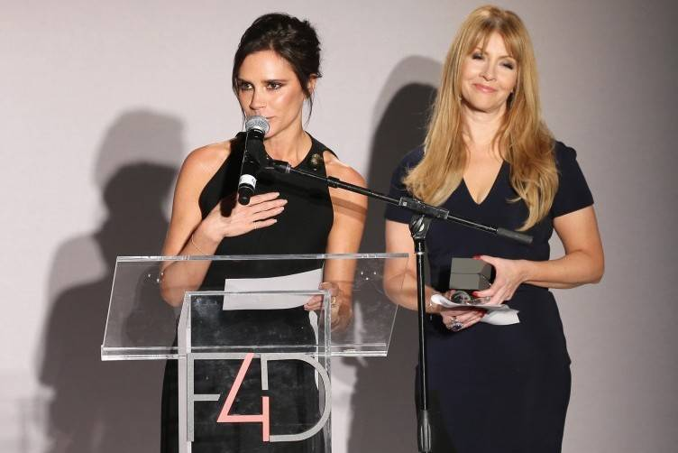 NEW YORK, NY - SEPTEMBER 28: UNAIDS goodwill ambassador Victoria Beckham (L) and F4D Founder Evie Evangelou speak onstage during the Fashion 4 Development's 5th annual Official First Ladies luncheon at The Pierre Hotel on September 28, 2015 in New York City. (Photo by Neilson Barnard/Getty Images for Fashion 4 Development)