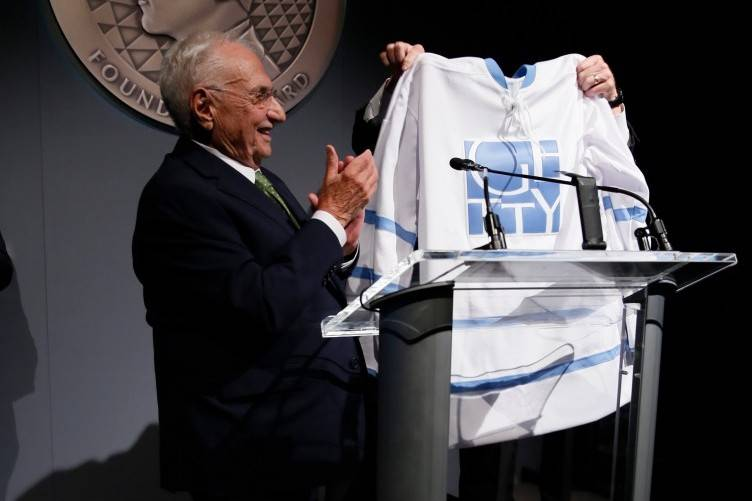 From left, honoree Frank Gehry is presented a special Getty hockey jersey by James Cuno, president and CEO of the J. Paul Getty Trust during the J. Paul Getty Medal Dinner honoring Frank Gehry