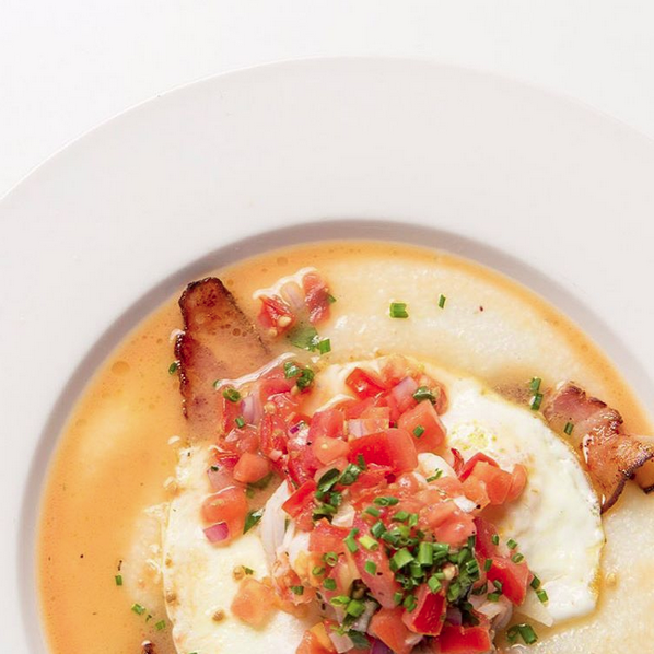Shrimp & Grits with tasty smoked bacon, two over easy eggs, and pico de gallo