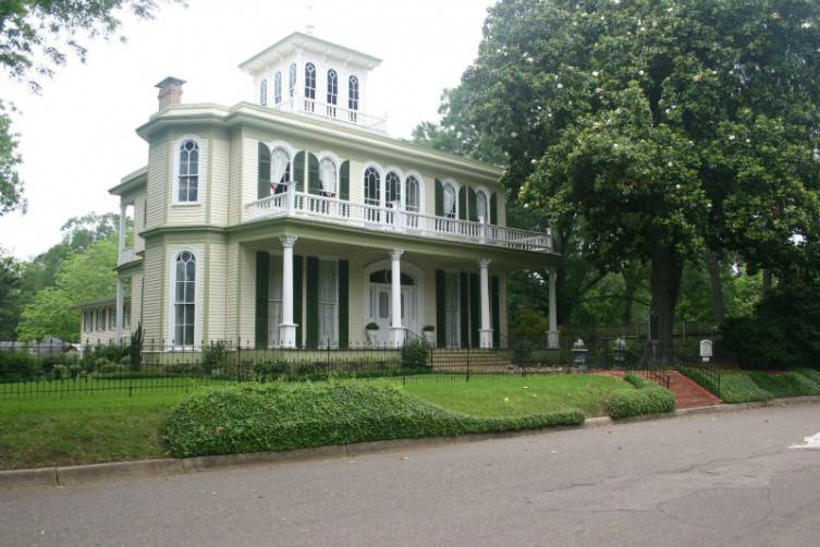 House of the Seasons is a beautiful Transitional Greek Revival built in 1872.
