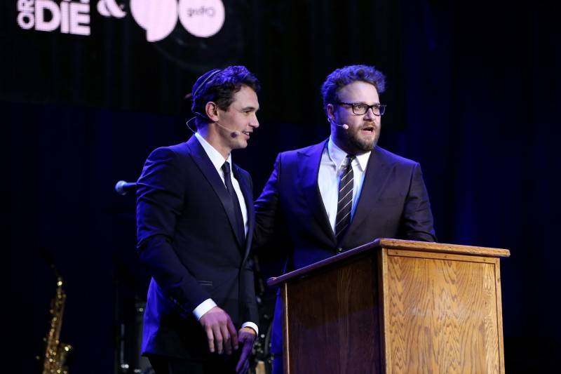 James Franco (L) and Hilarity for Charity co-founder/show host Seth Rogen perform onstage during Hilarity for Charity's annual variety show: James Franco's Bar Mitzvah, benefiting the Alzheimer's Association, presented by Funny or Die, go90 and SVEDKA Vodka at the Hollywood Palladium on October 17, 2015