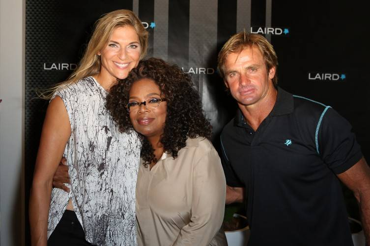 Professional volleyball player Gabrielle Reece, Oprah Winfrey, and professional surfer Laird Hamilton attend the launch of Laird Apparel by Laird Hamilton at Ron Robinson