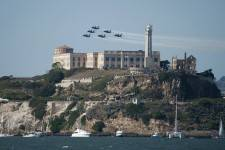 The U.S. Navy flight demonstration squadron, the Blue Angels, fly over Alcatraz Island during a performance for San Francisco Fleet Week 2011.