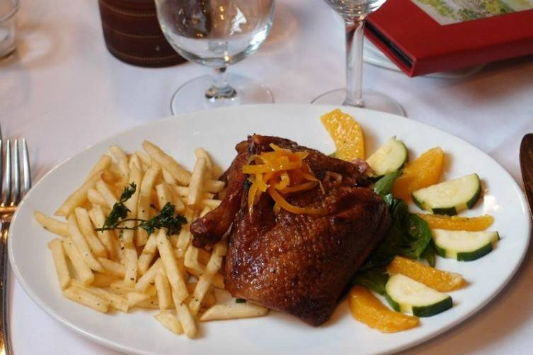 Classic French dishes like this beautiful duck are plated with creative attention to detail.