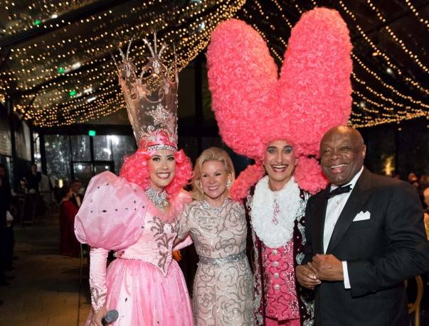 "Dede Wilsey, Willie Brown with cast members from ""Beach Blanket Babylon."""
