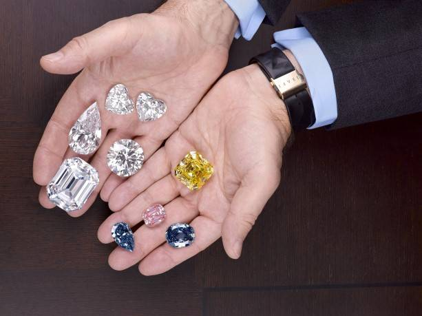 Laurence Graff holds a selection of the world's most valuable gemstones