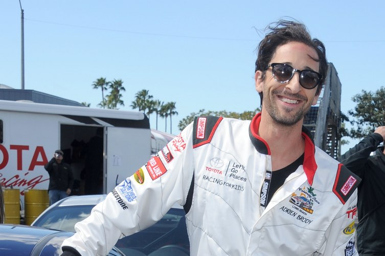 LONG BEACH, CA - APRIL 01: Actor Adrien Brody arrives at press day for the 2014 Toyota Pro/Celebrity Race on April 1, 2014 in Long Beach, California. (Photo by Gregg DeGuire/WireImage)