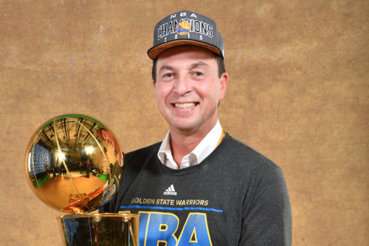 Joe Lacob holding the Larry O'Brien Championship trophy