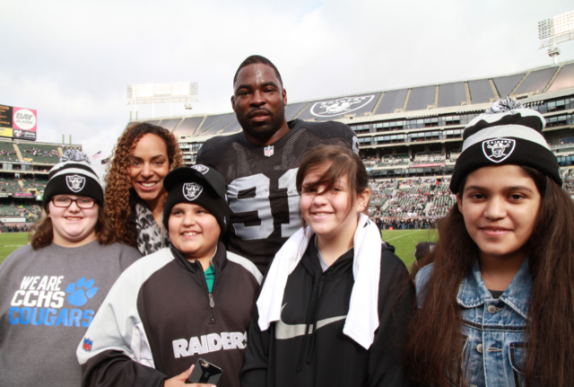 Lauran Tuck, Justin Tuck and Bay Area Tuck's R.U.S.H. for Literacy students