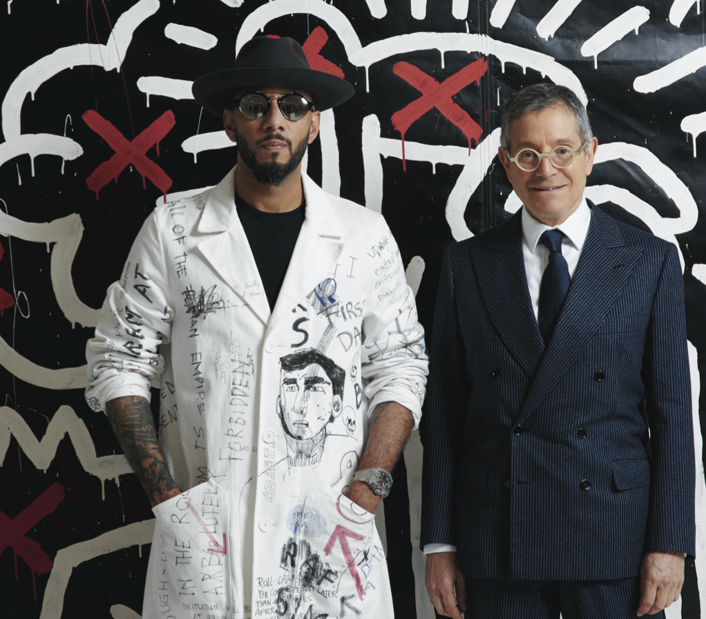 Swizz Beatz and Jeffrey Deitch standing in front of Keith Haring, Untitled, 1982. Photography by Mark Squires