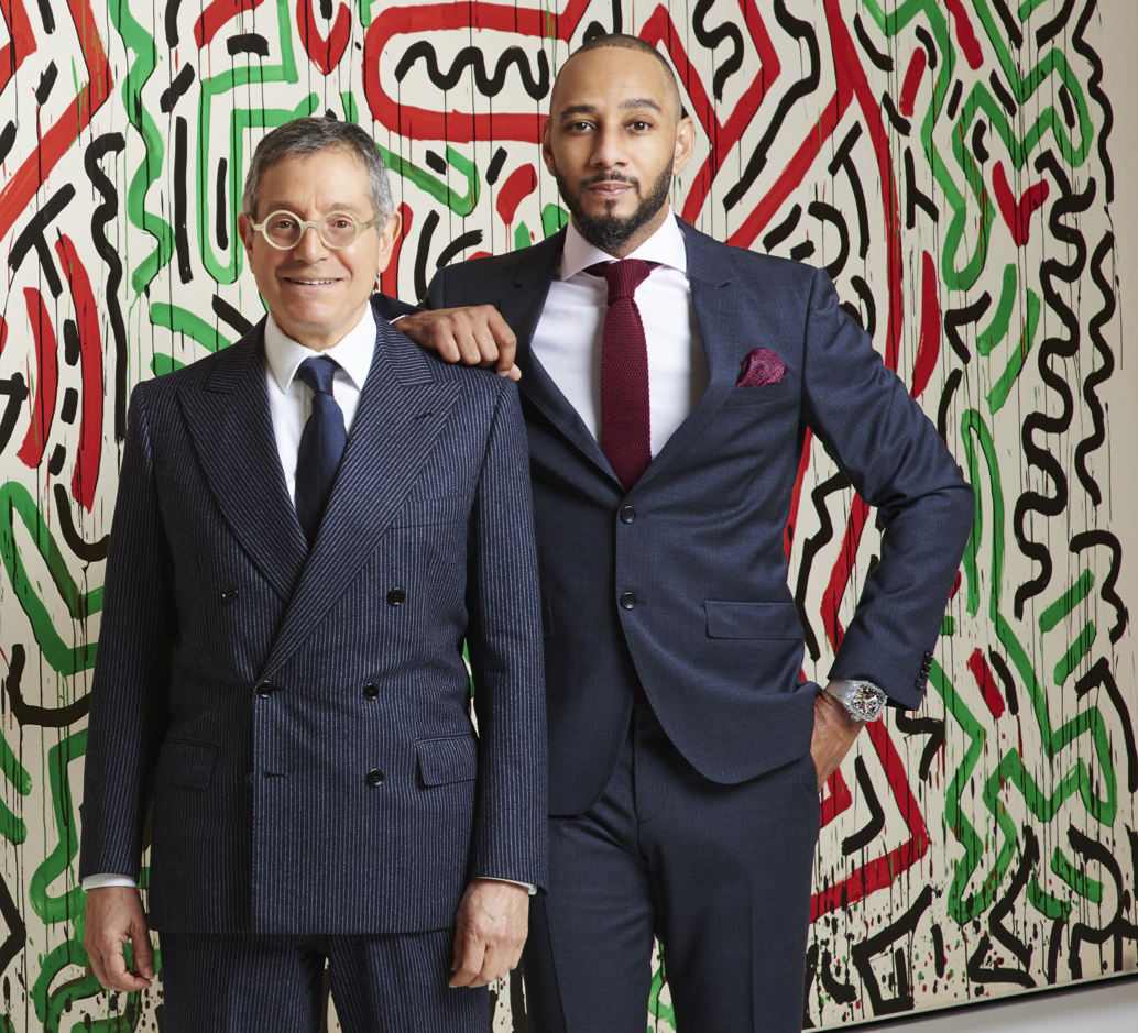 "Jeffrey Deitch shows Swizz Beatz his opening show at the Deitch Studio ""Keith Haring: Bombs and Dogs,"" presented by Jeffrey Deitch and Suzanne Geiss. Photography by Mark Squires."