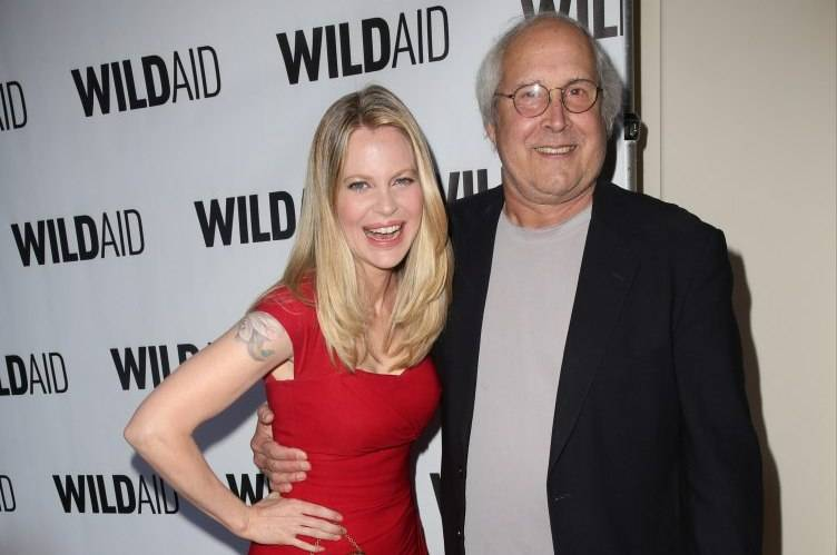 Kristen Bauer and Chevy Chase