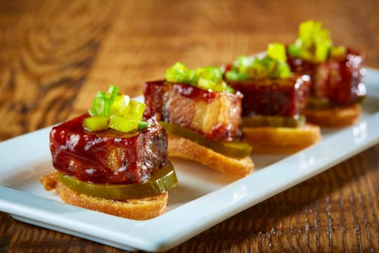 The pork belly appetizer is glazed with an ancho barbecue sauce.