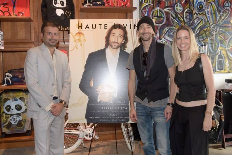 Kamal Hotchandani, Adrien Brody and Hadley Henriette attend Haute Living & Adrien Brody Cover Release Party at Lulu Laboratorium on December 3, 2015 in Miami, Florida. (Photo by Romain Maurice/Getty Images for Haute Living)