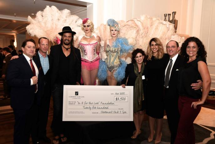 Members of Bay Area Fairmont Hotels and Resorts check presentation to Michael Franti's Do It For the Love Foundation.