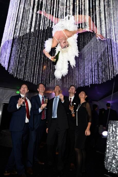 Attendees fill Champagne glasses from Dancing Crystal Chandelier