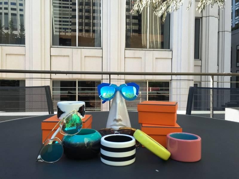 Hermes bracelets, Dior sunglasses, Karen Walker sunglasses