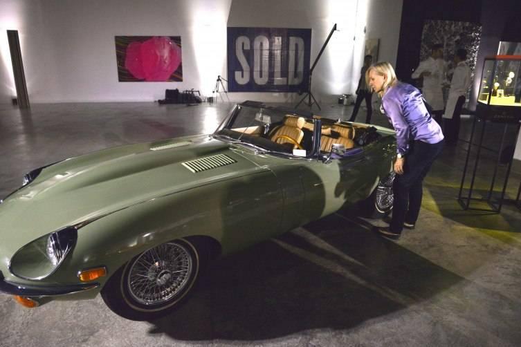 Martina inspects a vintage Jag