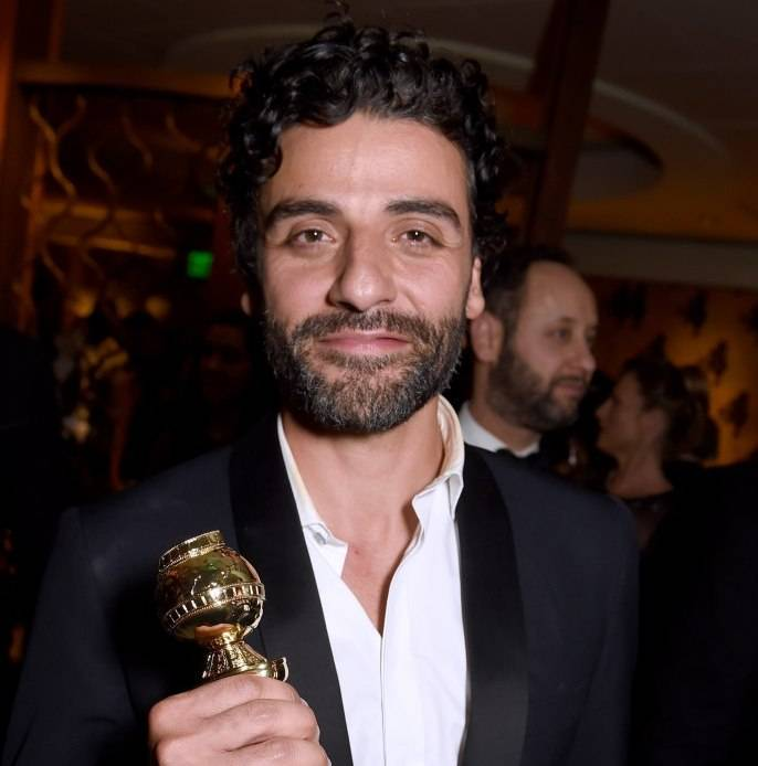 Oscar Isaac poses with his award for Best Actor at HBO's Official Golden Globe Awards After Party at The Beverly Hilton Hotel on January 10