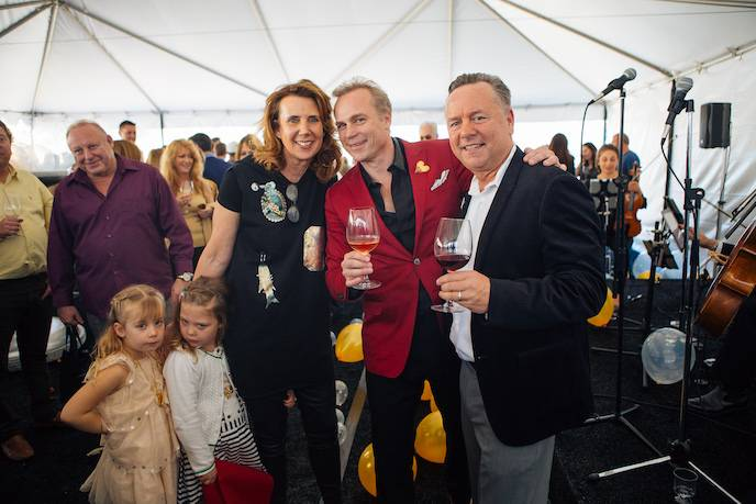 Gina Gallo and Jean-Charles Boisset are flanked by their twins, Honorée-Josephine and Grace-Antoinette, and Yountville Mayor John Dunbar at the grand opening
