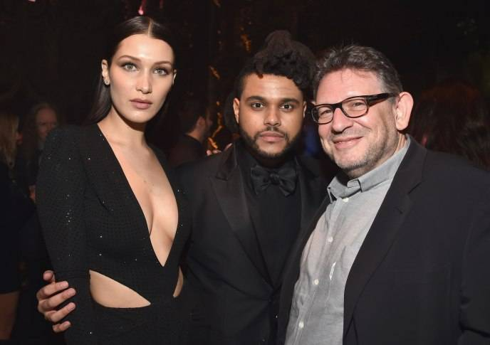 Model Bella Hadid, singer The Weeknd and CBE Chairman and CEO Lucian Grainge attend Universal Music Group 2016 Grammy After Party