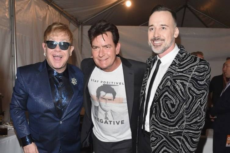 Host Elton John, actor Charlie Sheen and host David Furnish attend the 24th Annual Elton John AIDS Foundation's Oscar Viewing Party