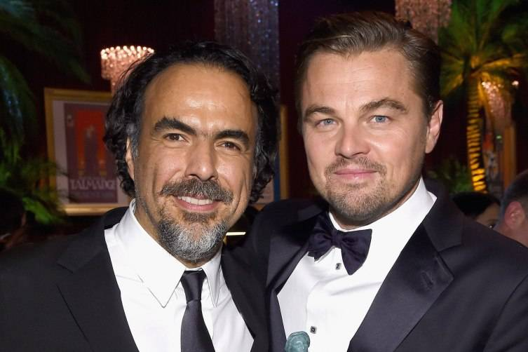 Director Alejandro G. Iñárritu (L) and actor Leonardo DiCaprio attend People and EIF's Annual Screen Actors Guild Awards Gala at The Shrine Auditorium on January 30