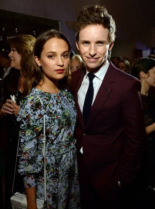 Alicia Vikander (L) and Eddie Redmayne attend the Film is GREAT Reception