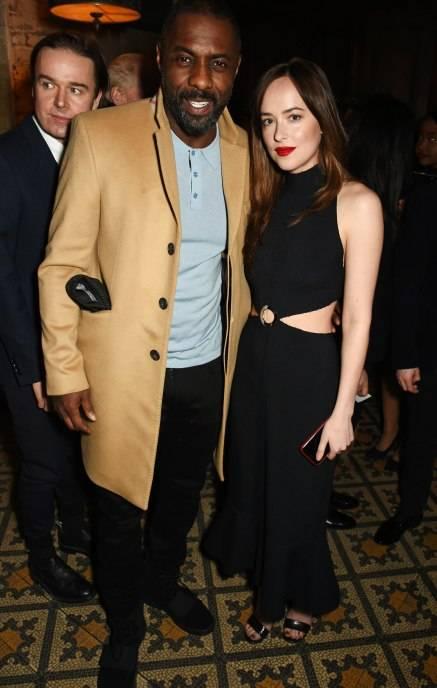 Idris Elba and Dakota Johnson attend Harvey Weinstein's pre-BAFTA dinner