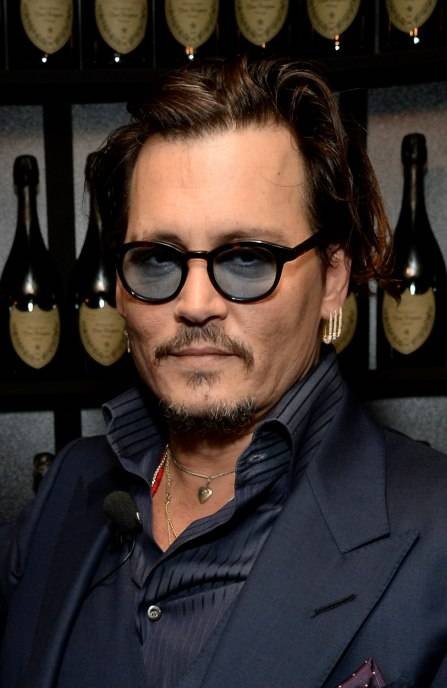 Johnny Depp visits the Dom Perignon Lounge before receiving the Maltin Modern Master Award at The Santa Barbara International Film Festival on February 4