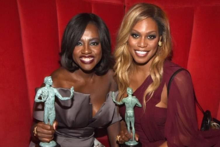 Viola Davis and Laverne Cox holding their SAG Awards