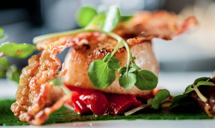 Seared scallops are one of Jamie Roberton's delicious dishes that you'll find on the menu at Gaucho in Dubai.