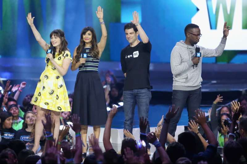 Zooey Deschanel, Hannah Simone, Max Greenfield, and Lamorne Morris speak onstage at WE Day California