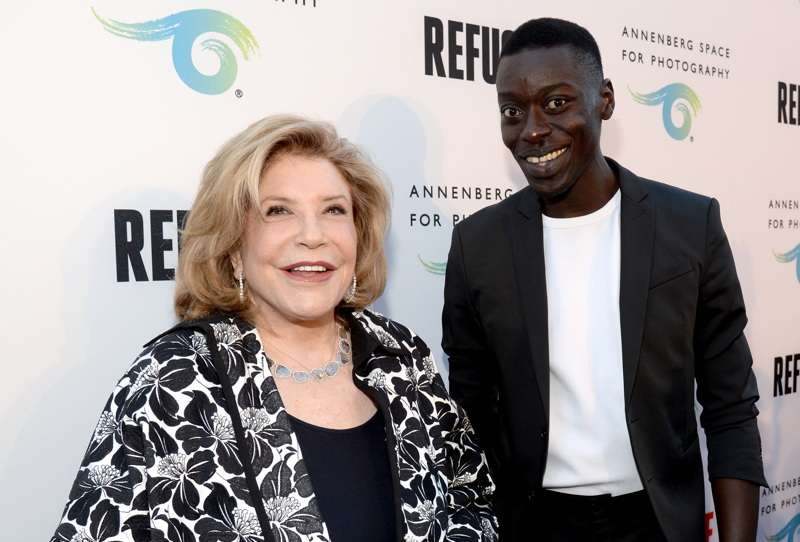 President and Chairman of the Board of The Annenberg Foundation, Wallis Annenberg (L) and featured artist Omar Victor Diop attend the opening of REFUGEE Exhibit at Annenberg Space For Photography