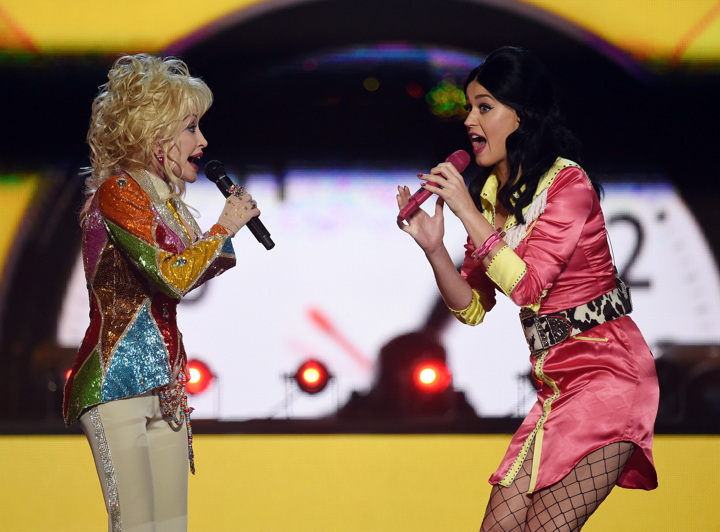 Honoree Dolly Parton (L) and recording artist Katy Perry perform