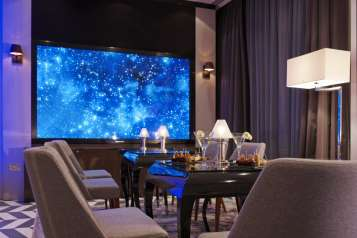 the-hotels-ground-floor-media-lounge-features-a-massive-103-3dhd-cinema-screen-and-provides-complimentary-wi-fi-and-plentiful-ports