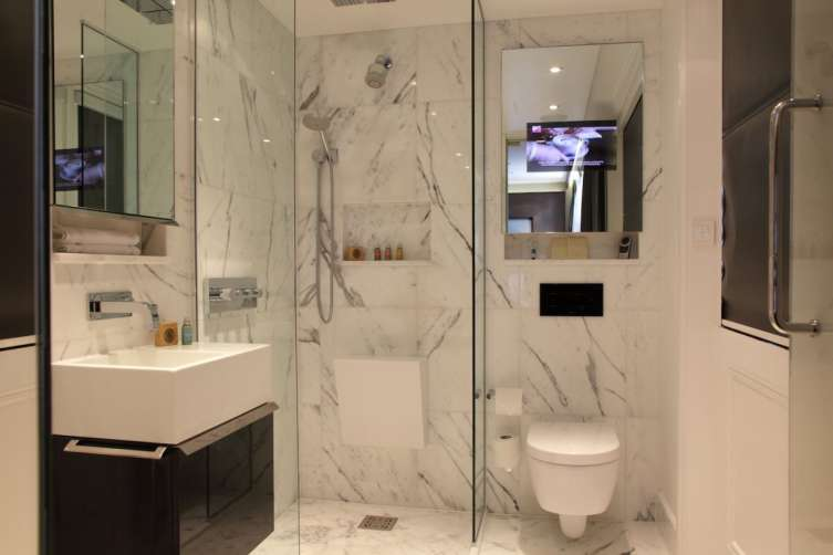 the-italian-marbled-bathrooms-are-kitted-with-underfloor-heating-and-a-flatscreen-tv-embedded-in-the-mirrors