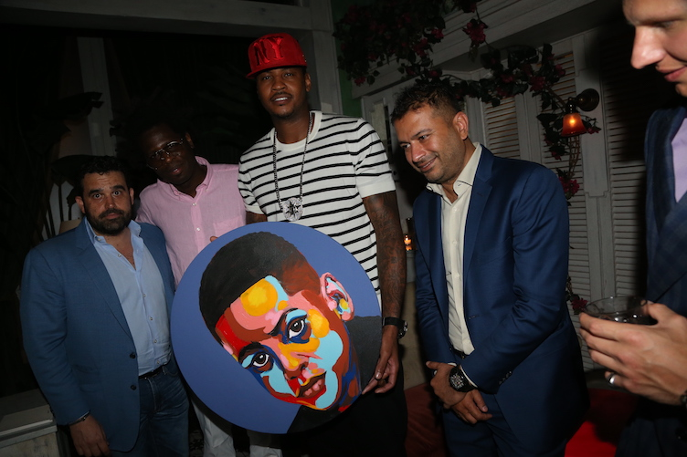 (L-R) Seth Semilof, Brad Digital, Carmelo Anthony, and Kamal Hotchandani celebrate Carmelo Anthony's birthday at Socialista on May 28, 2016 in New York City. (Photo by Johnny Nunez/Getty Images for Haute Living)