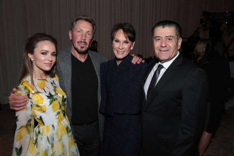 Nikita Kahn, Larry Ellison, Cheryl Saban and Haim Saban attend as the USC Keck School of Medicine hosts the 3rd annual Rebels With a Cause gala at the Barker Hangar