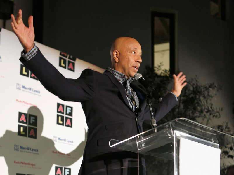 Host Russell Simmons speaks onstage during Russell Simmons' Rush Philanthropic Arts Foundation's inaugural Art For Life Los Angeles at Private Residence