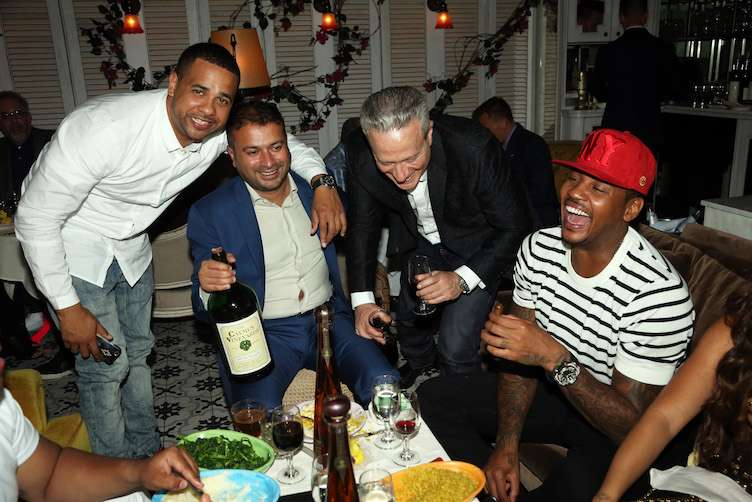 NEW YORK, NY - MAY 28: (L-R) Christian Vazquez, Kamal Hotchandani, Bobby Schagrin, and Carmelo Anthony celebrate Carmelo Anthony's birthday at Socialista on May 28, 2016 in New York City. (Photo by Johnny Nunez/Getty Images for Haute Living)