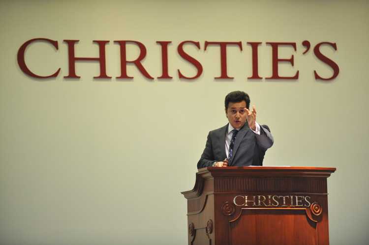 Rahul Kadakia, Christie's International Head of Jewelry at the rostrum in Hong Kong.