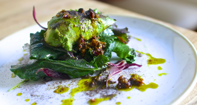 Charred avocado with pistachio, ash and kale
