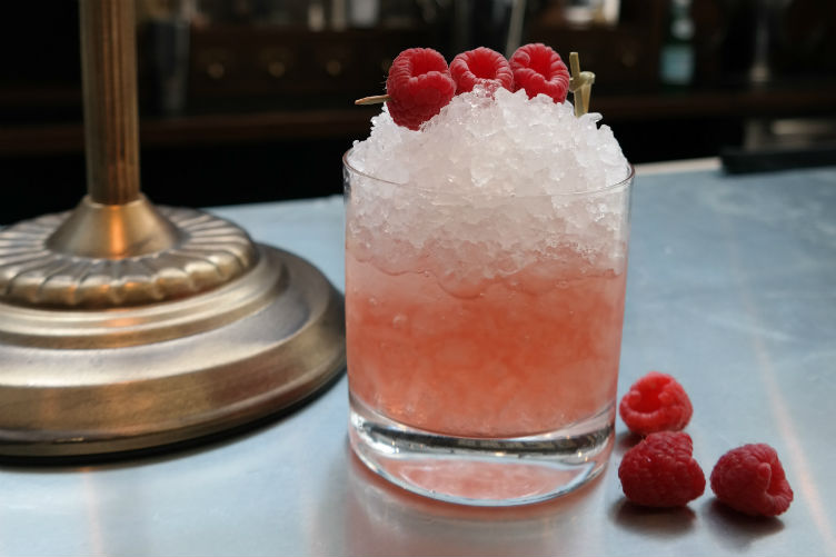 "The ""Gin Fix"" consists of The Botanist Gin, fresh lime juice, simple syrup and rasberries"