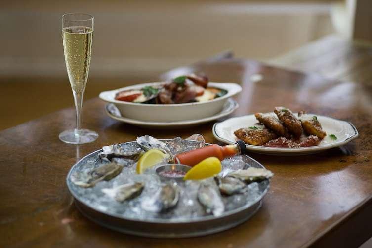 Oysters, eggplant parmesan, and toasted raviolis.